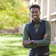 Handsome young black man smiles on college campus - PhotoDune Item for Sale