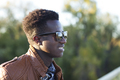 Handsome young black man with sunglasses on fall day - PhotoDune Item for Sale