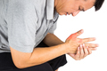 Man with painful and inflamed gout on his hand around the thumb area - PhotoDune Item for Sale