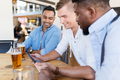 male friends with tablet pc drinking beer at bar - PhotoDune Item for Sale