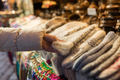woman buying woolen mittens at christmas market - PhotoDune Item for Sale