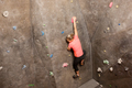 young woman exercising at indoor climbing gym - PhotoDune Item for Sale