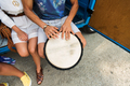 close up of hippie friends playing tom-tom drum - PhotoDune Item for Sale