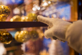 hand pointing at christmas toys behind shop window - PhotoDune Item for Sale
