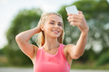 happy woman taking selfie with smartphone outdoors