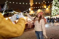 happy woman posing for smartphone at christmas - PhotoDune Item for Sale