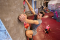 man and woman exercising at indoor climbing gym - PhotoDune Item for Sale