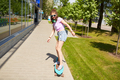 happy teenage girl in shades riding on longboard - PhotoDune Item for Sale