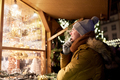 happy man looking at christmas market shop window - PhotoDune Item for Sale