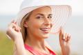 portrait of beautiful smiling woman in sun hat