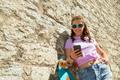 happy teenage girl with longboard and smartphone