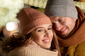 close up of happy couple in winter clothes