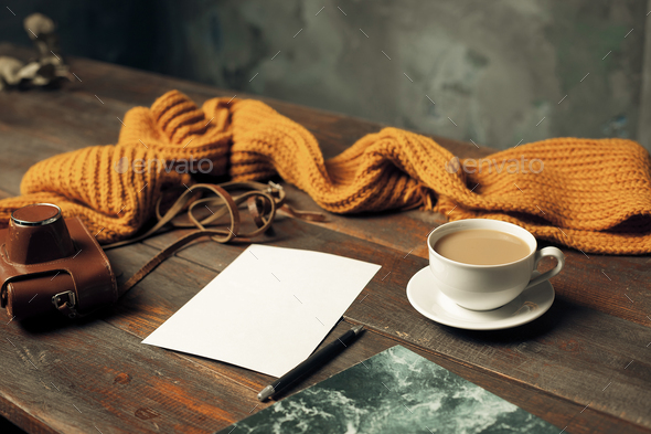 Opened craft paper envelope , autumn leaves and coffee on wooden table - Stock Photo - Images