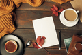 Opened craft paper envelope , autumn leaves and coffee on wooden table