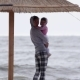 Young Mother with Little Daughter Walking Along the Sea in Bad Weather - VideoHive Item for Sale