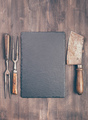 Slate coaster with meat cleaver and fork