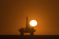 Sun setting over oil drilling platform at Longbeach in Namibia - PhotoDune Item for Sale