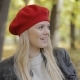 Woman in Red Beret Sitting on Bench