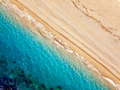 Top view of a deserted beach. The greek coast of the Ionian Sea