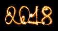 2018 with sparklers on black background