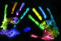 Multicolored hand prints on black