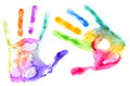 Multicolored hand prints on white