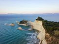 Aerial photo of Cape Drastis at Corfu island in Greece at sunset