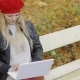 Pretty Woman Using Laptop in Autumn Park