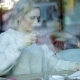 Woman Drinking Tea and Using Laptop