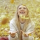 Woman Rejoicing at Falling Leaves