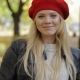 Attractive Woman in Red Beret in Park