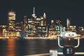 New Your City skyline with binoculars at night, USA.