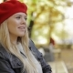 Woman in Red Beret Relaxing on Bench