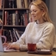 Attractive Woman in Jumper Using Laptop