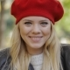 Happy-looking Woman in Red Beret