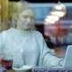 Pretty Woman Using Laptop Behind Window - VideoHive Item for Sale