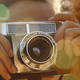 Woman taking pictures with vintage camera. Travel background. Fall season  - PhotoDune Item for Sale