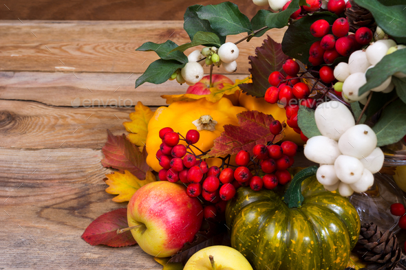 Fall background with snowberry, rowan, green and yellow squash - Stock Photo - Images