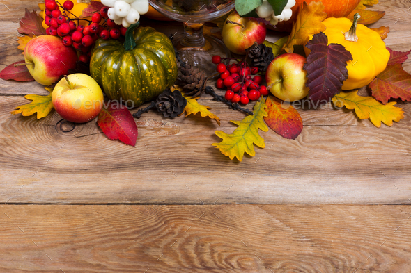 Fall background with green pumpkin, yellow squash, oak leaves, c - Stock Photo - Images