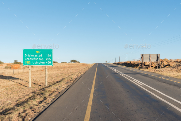 Distance road sign between Kimberley and Griekwastad - Stock Photo - Images