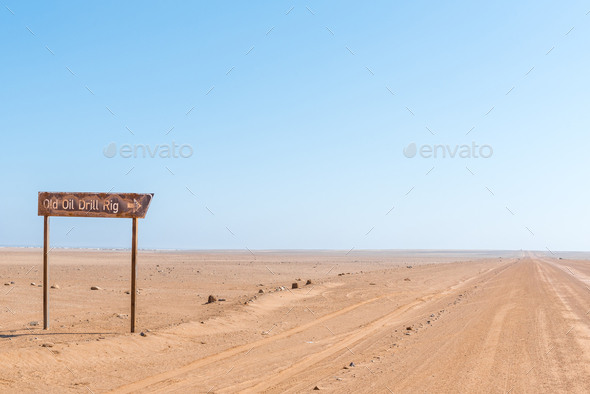 Turn-off from C34-road to rusted oil drilling rig - Stock Photo - Images