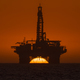 Sun setting behind oil drilling platform at Longbeach in Namibia - PhotoDune Item for Sale