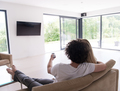 Rear view of couple watching television