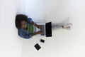 african american woman sitting on floor with laptop top view - PhotoDune Item for Sale
