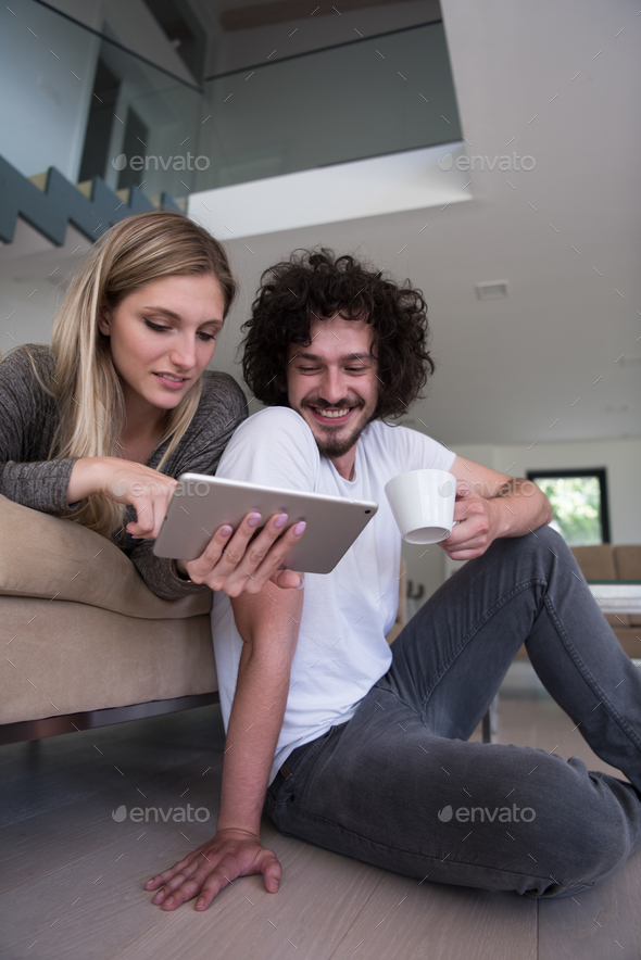 couple relaxing at  home with tablet computers - Stock Photo - Images