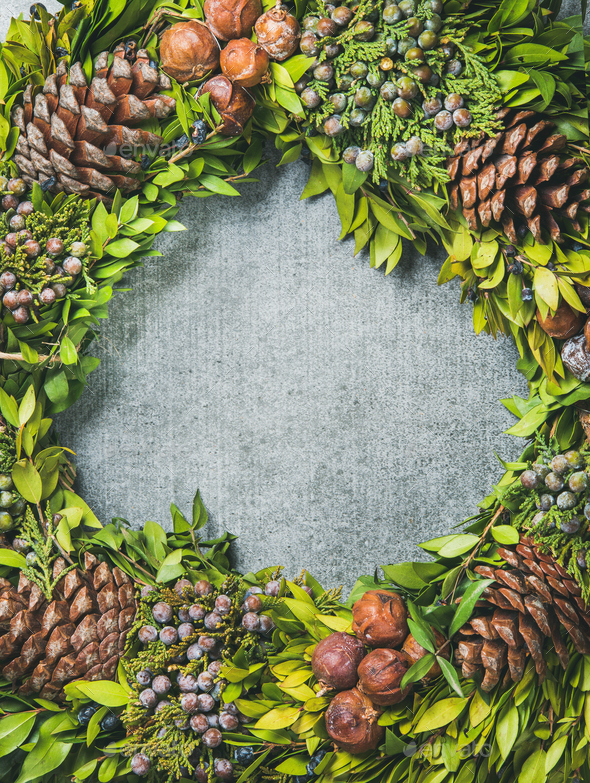 Christmas decorative wreath over concrete background, copy space - Stock Photo - Images