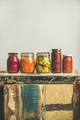 Autumn pickled vegetables in jars placed in line, copy space