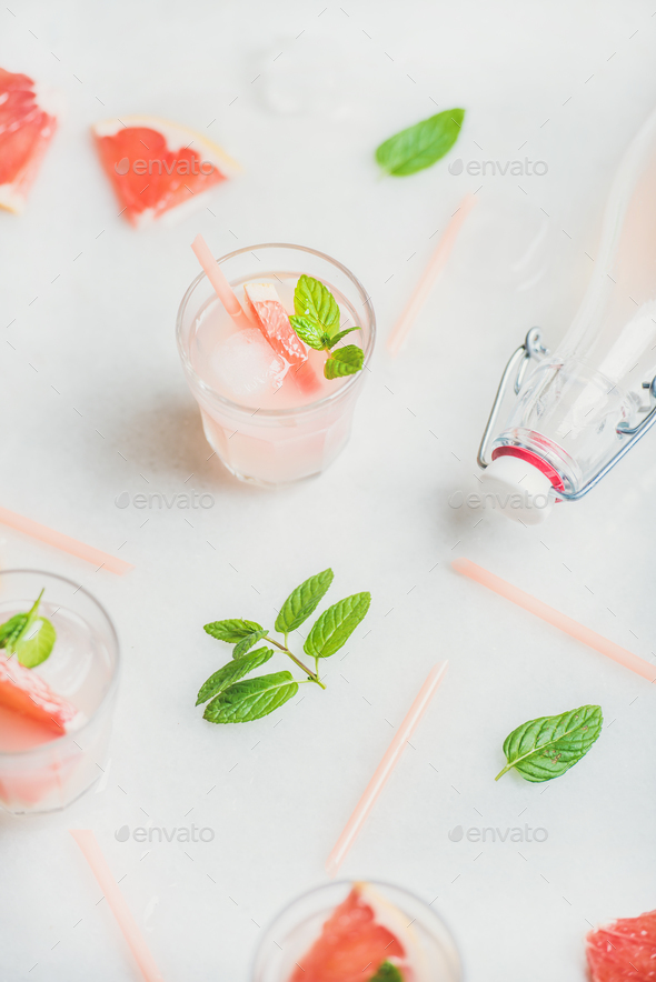 Cold refreshing summer alcohol cocktail with fresh grapefruit - Stock Photo - Images