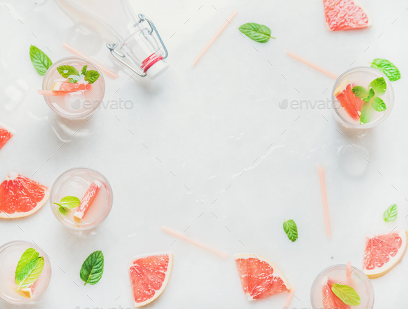 Cold refreshing alcohol cocktail with fresh grapefruit, copy space - Stock Photo - Images