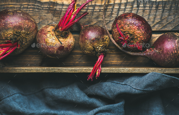 Raw organic purple beetroots in wooden box - Stock Photo - Images